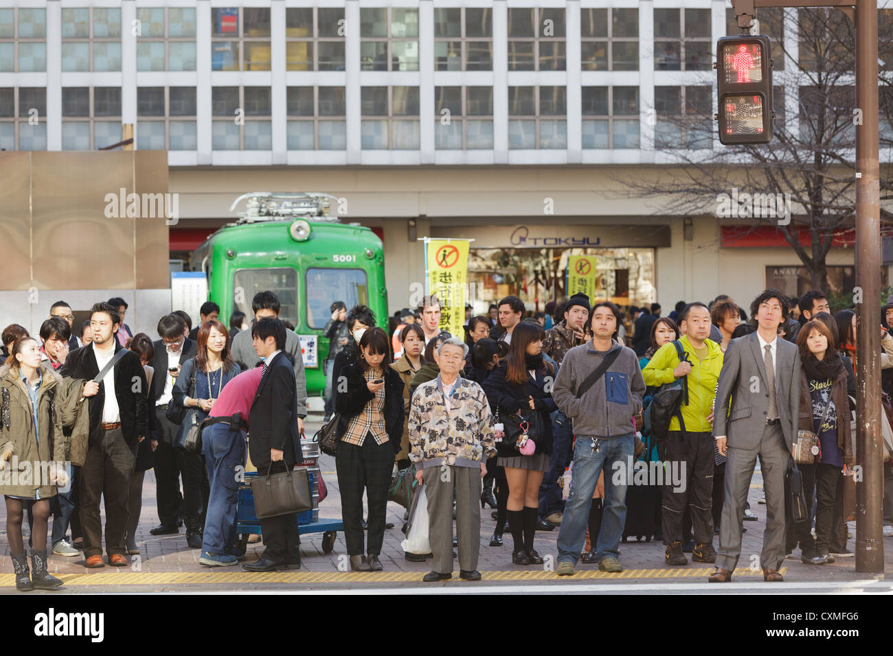 Gpa Calculation Japanese People Waiting For Crossing At Hachiko Crossroad  In Shibuya District, Tokyo,