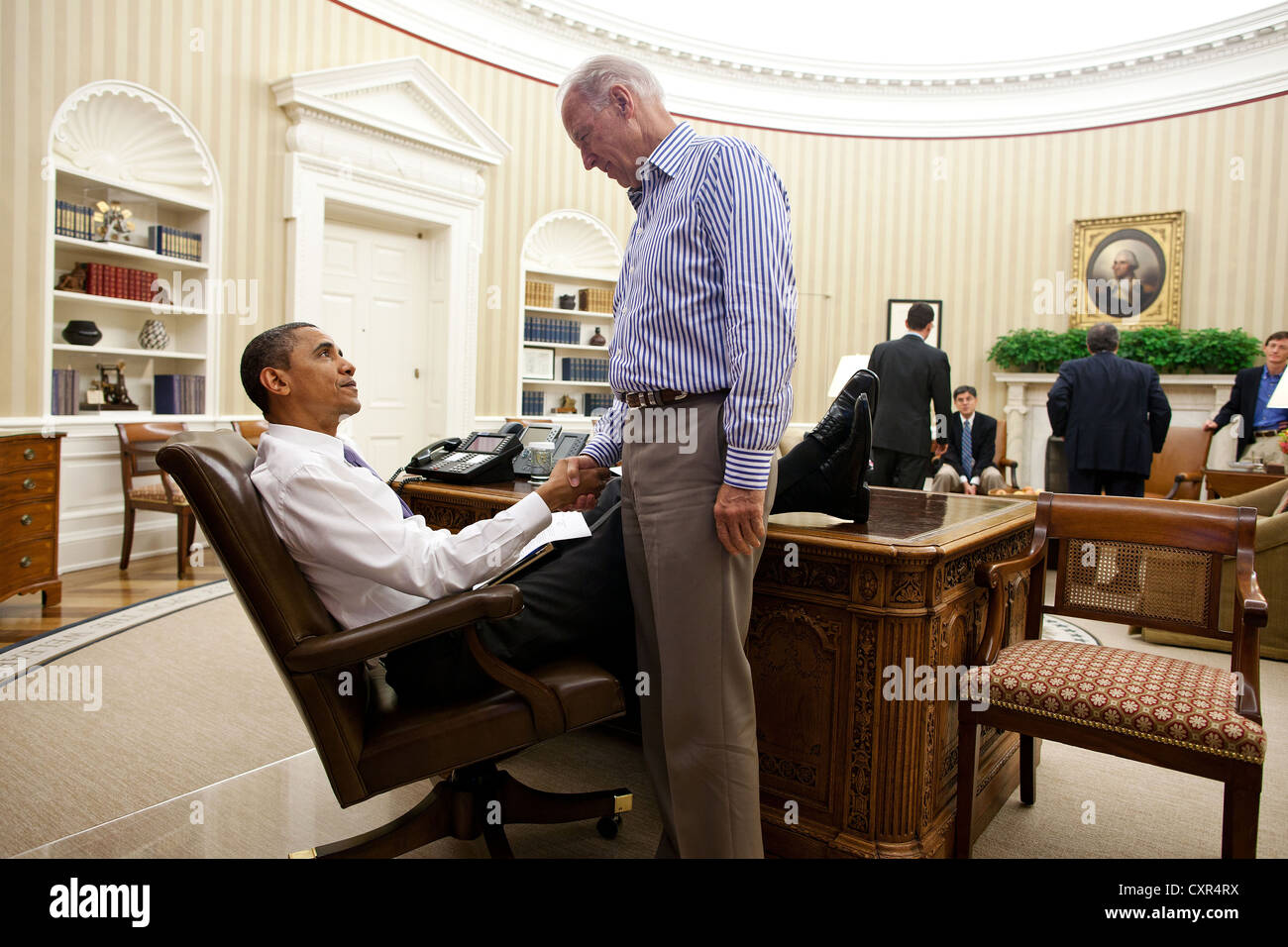 us president office. stock photo us president barack obama and vice joe biden shake hands july 31 2011 in the oval office following a phone call with house speaker us i