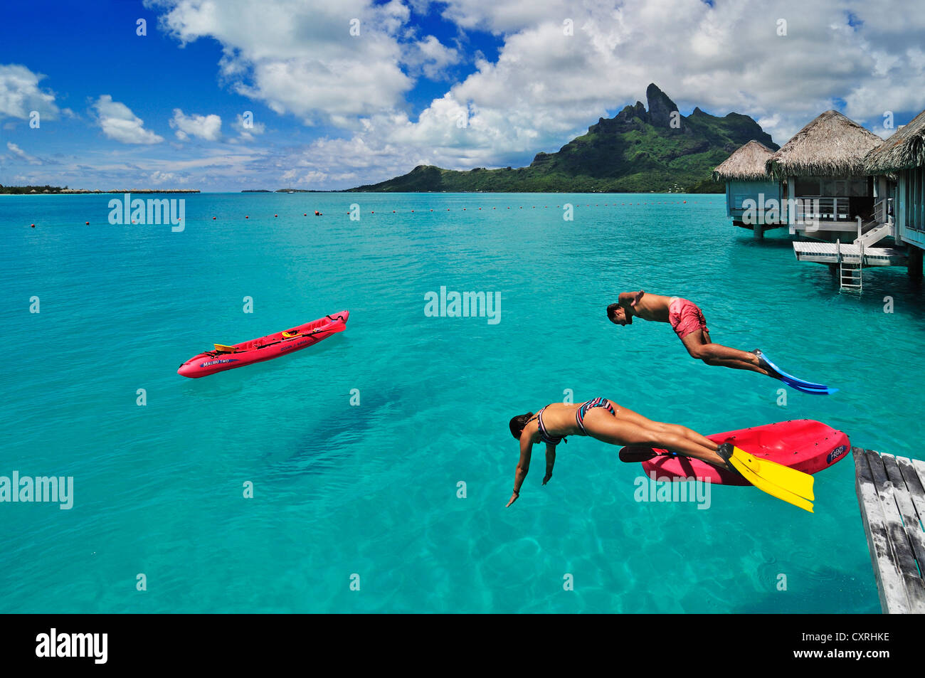Tourists jumping into the water st regis bora bora for What to buy in bora bora