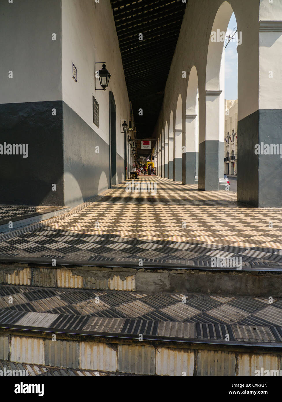 A one point perspective of diamond shaped floor tiles in a loggia a one point perspective of diamond shaped floor tiles in a loggia with white and gray archways in asuncin paraguay dailygadgetfo Choice Image