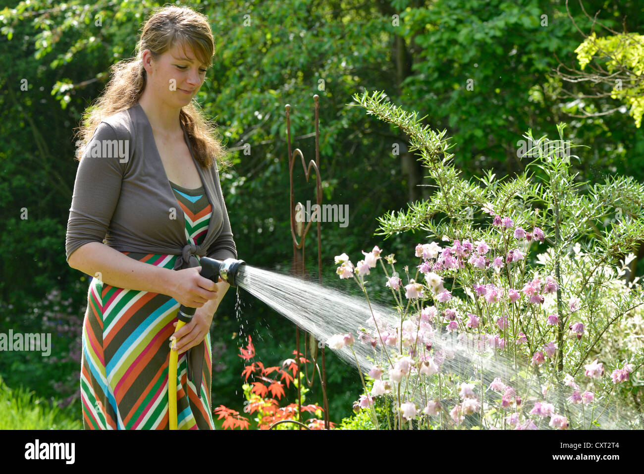 single bbw women in spring garden Woman having a coffee break while working in the garden, spring gardening concept crocus yellow grows in a spring garden in the snow beautiful primrose with drops of dew on a green background.