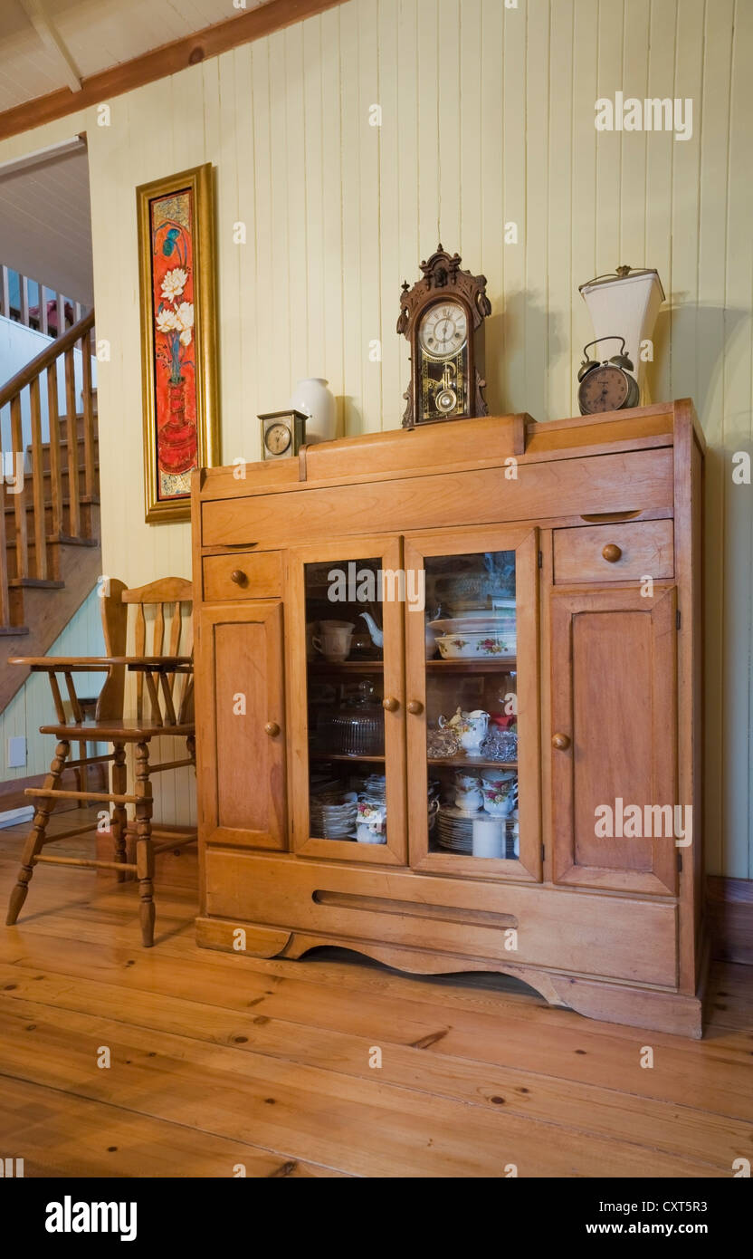 High Chair And Small Dresser In The Dining Room Of An Old Canadiana Cottage Style Residential Fieldstone Home Circa 1832