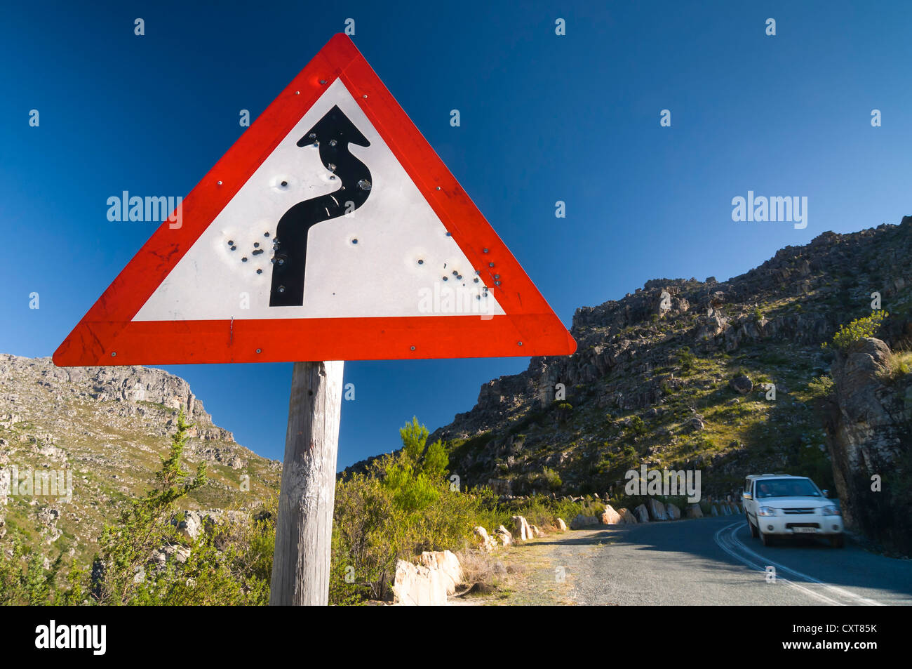 Shot road sign winding road car on the road western cape south shot road sign winding road car on the road western cape south africa africa publicscrutiny Images
