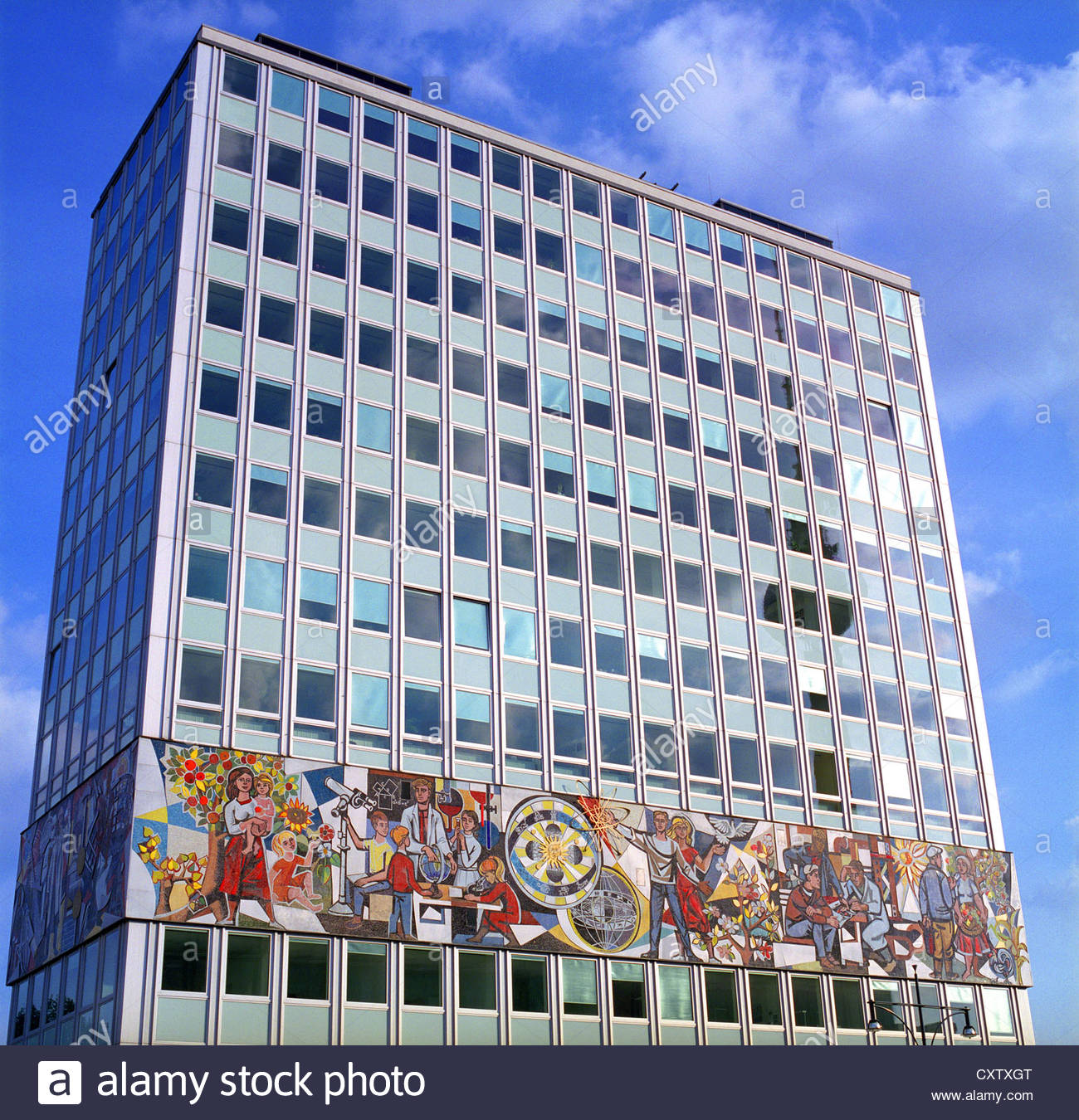 A communist mural on the facade of the haus des lehrers for Mural on building