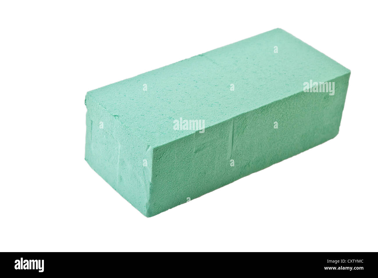 a block or brick of wet floral foam used by florist in the of flower using fresh flowers