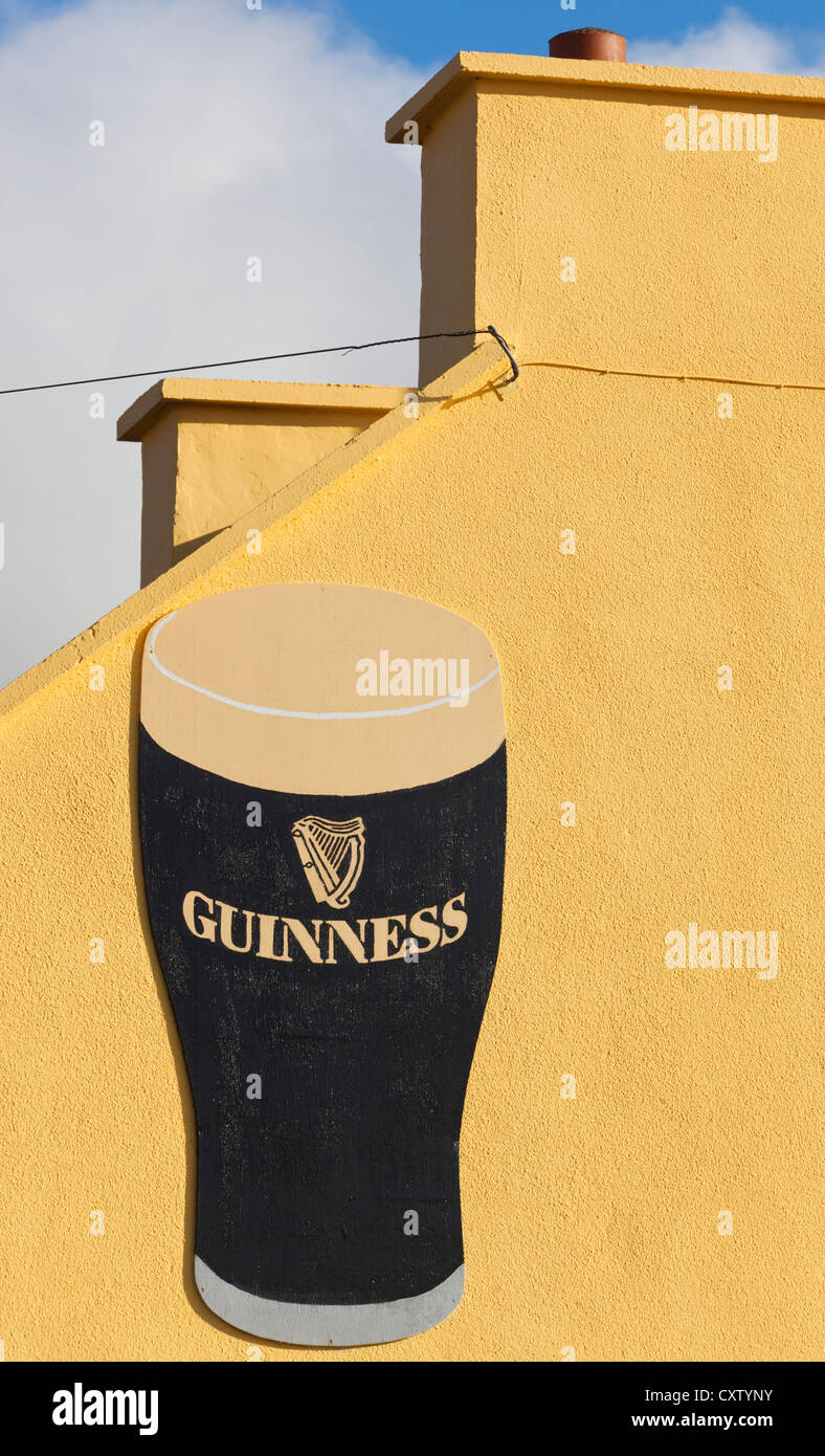 Ireland. Advertisement for Guinness stout painted on wall Stock ...