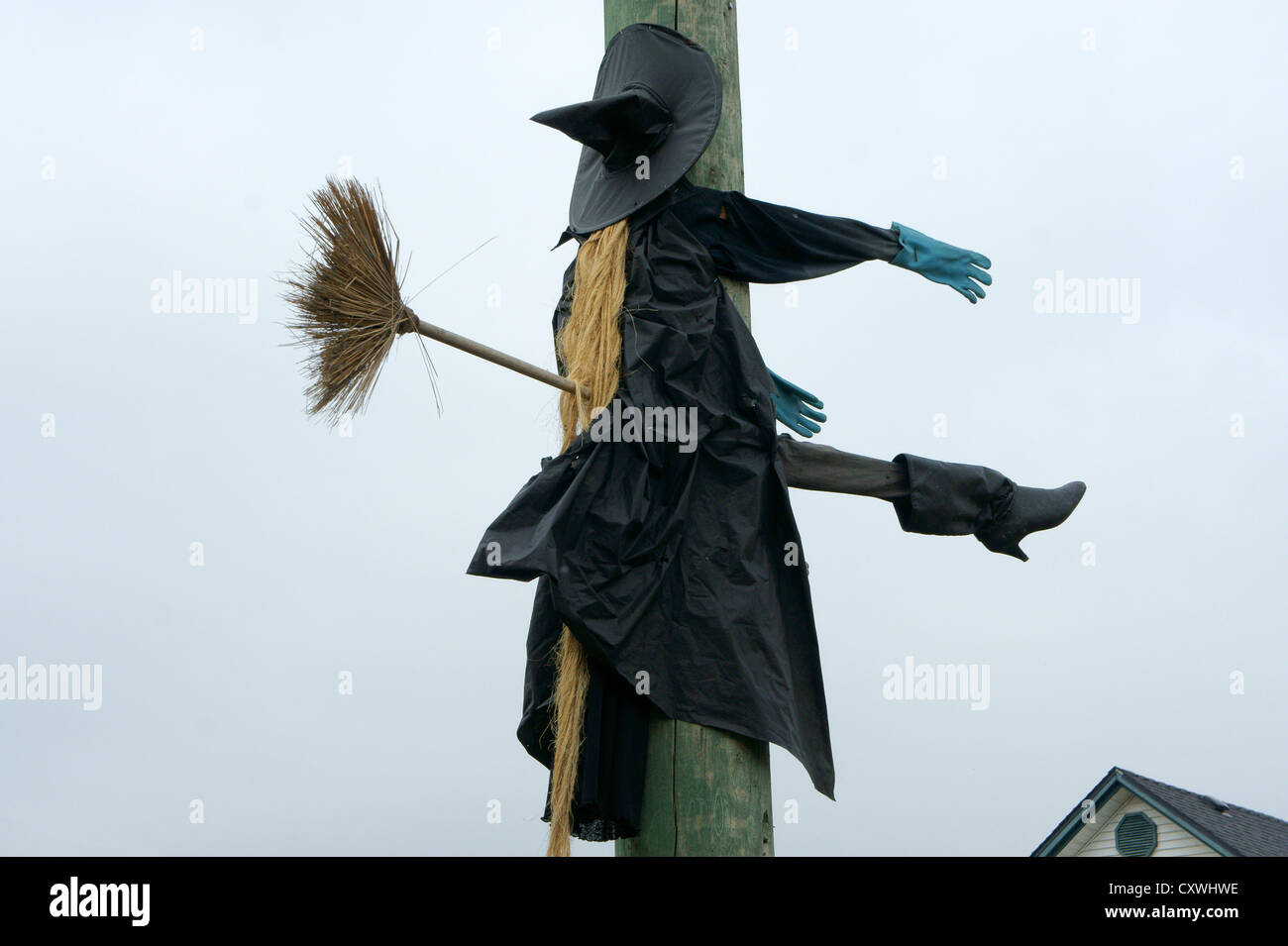 humorous halloween sculpture of an unlucky flying witch hitting a telephone pole - Flying Halloween Witch