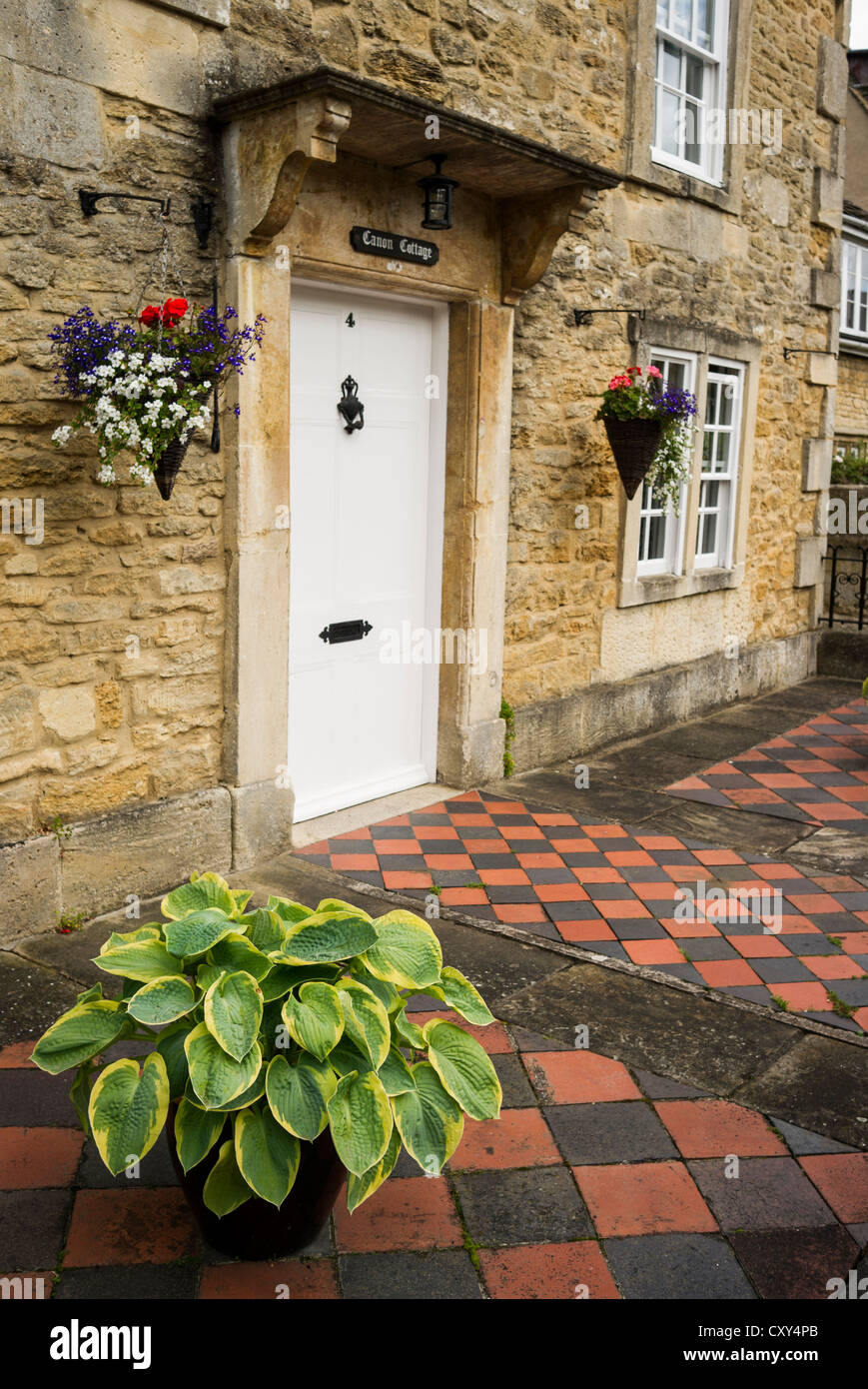 Hosta Decorating A Simple Tiled Patio In Front Garden Of Town House In UK    Stock