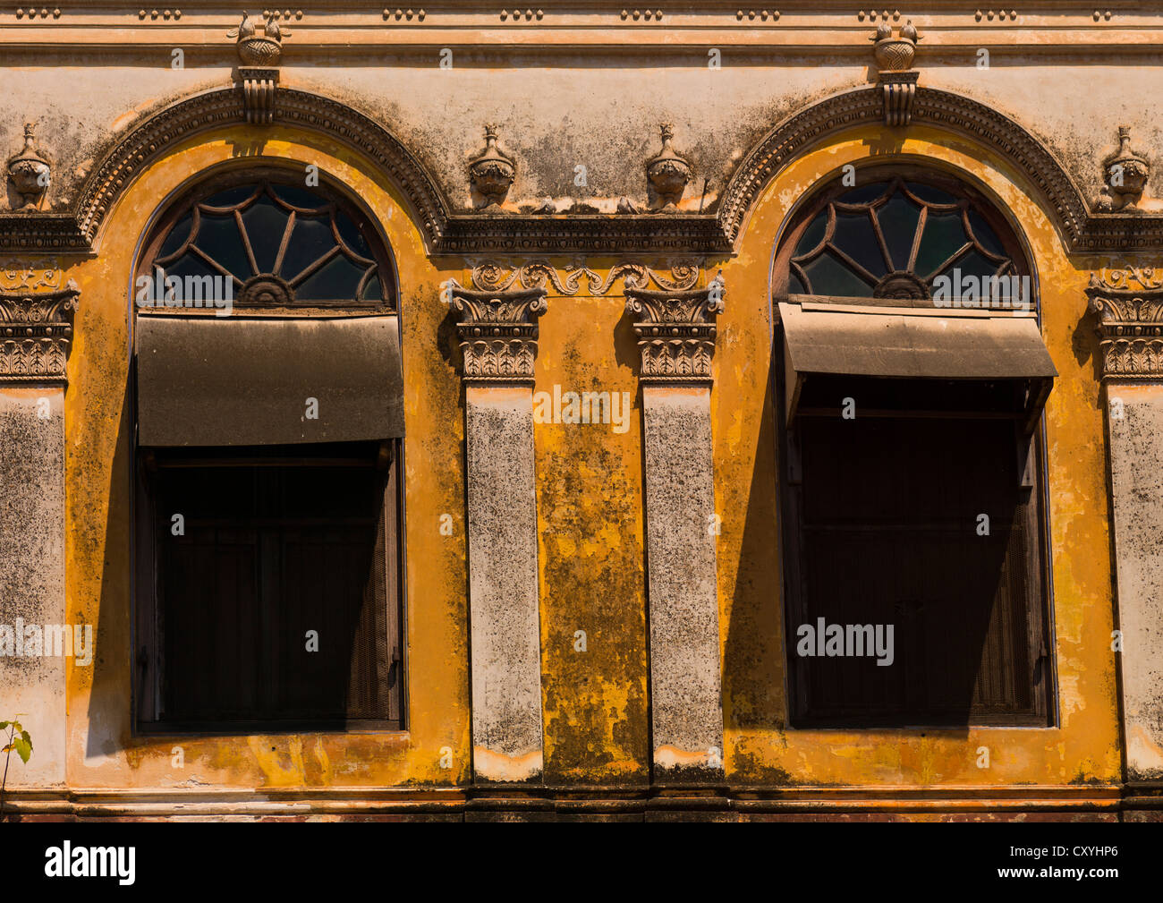 Stock photo two windows of an old house with decrepit wall pondicherry india