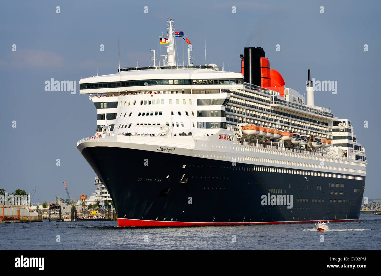 Cruise Ship Queen Mary 2 Size Comparison With A Sports Boat In The Stock Pho