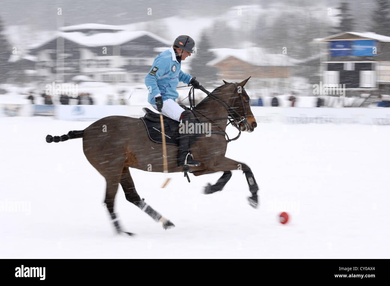 uwe schroeder of team tom tailor riding through the snow polo stock photo royalty free image. Black Bedroom Furniture Sets. Home Design Ideas