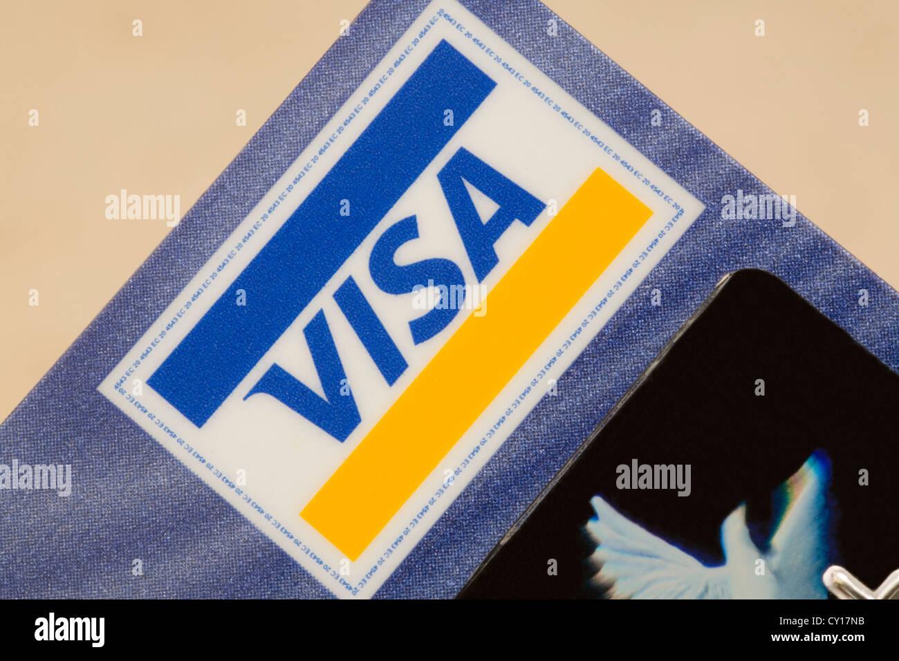 Visa logo sign in close up by hologram on plain background stock visa logo sign in close up by hologram on plain background biocorpaavc Choice Image