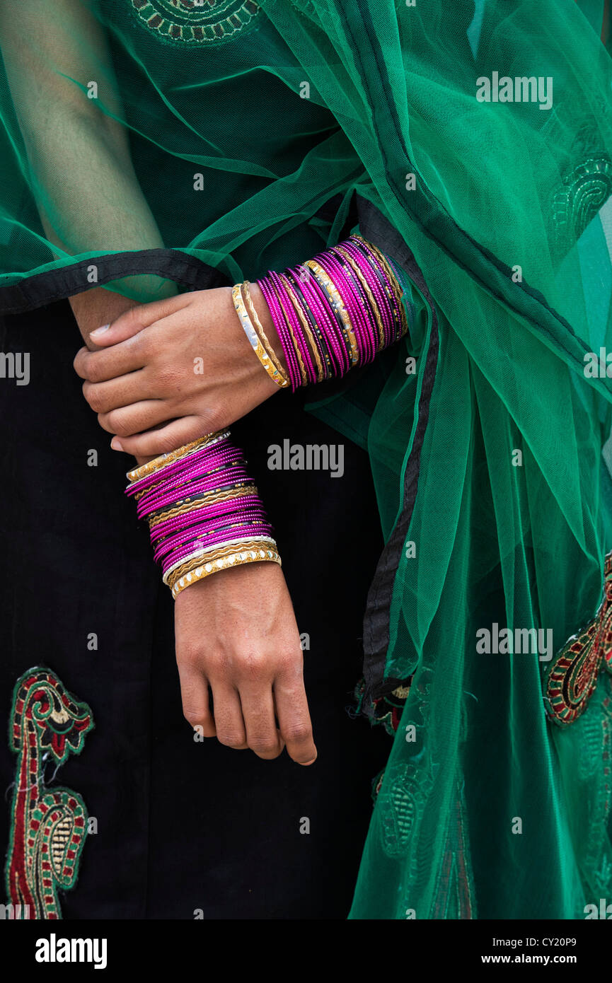 Teenage indian girls hands and bangle with green veil. India Stock ...