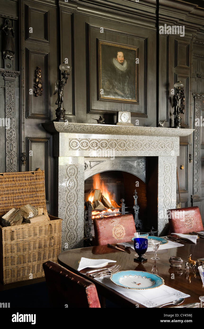 Open Fireplace In Dining Room With Original Elizabethan Wood Wall Panelling