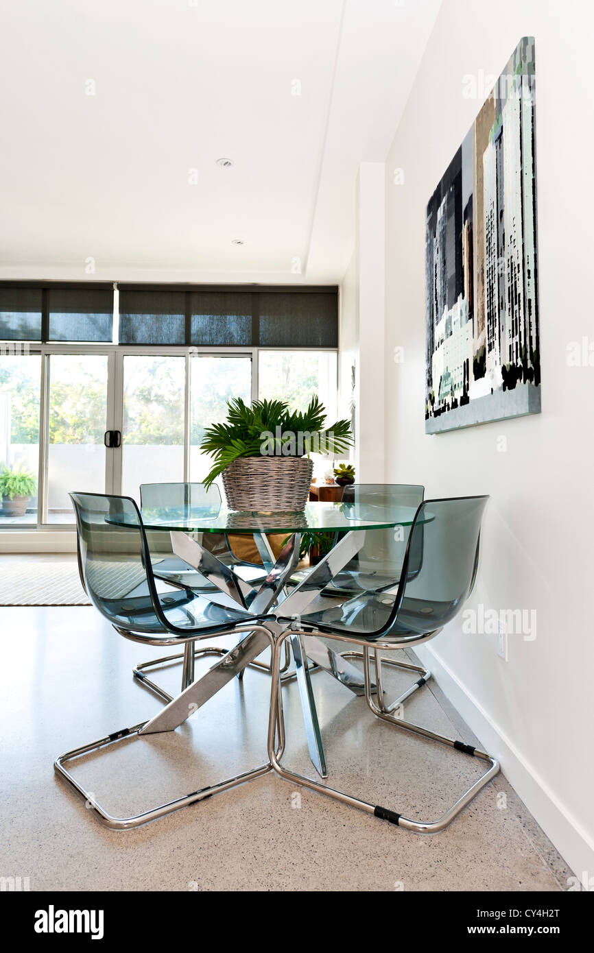 Dining table and chairs in loft apartment - artwork from ...