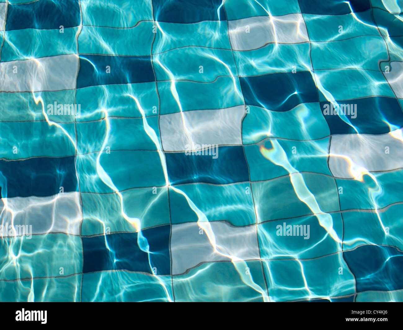 blue swimming pool tiles under water with sunlight patterns Stock ...