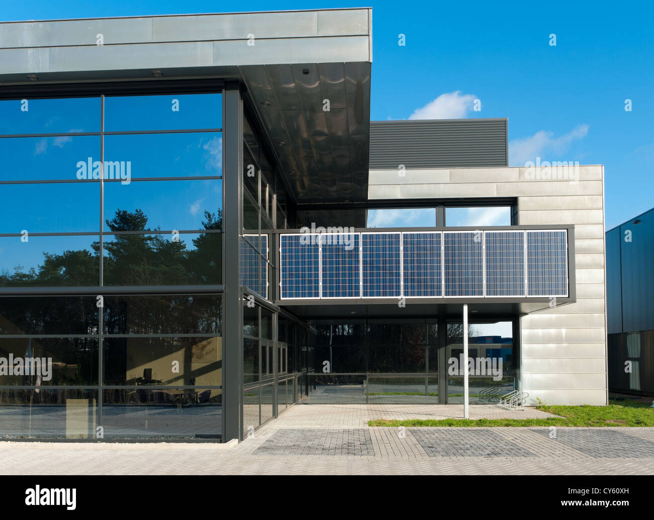 Solar Powered Office Buildings : Modern office building with solar panels above the