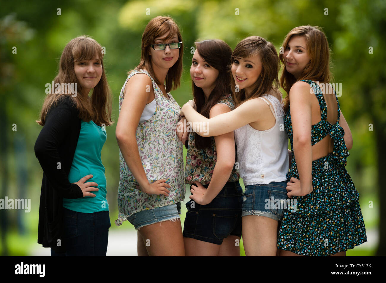 youngster girls ... A group of five 5 young adolescent british english welsh teen teenage  girls friends standing together