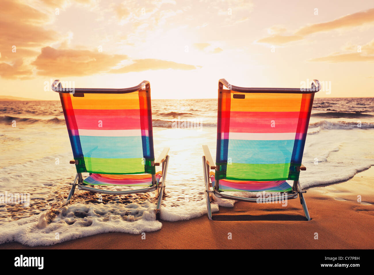 Hawaiian Vacation Sunset Concept Two Beach Chairs at Sunset Stock