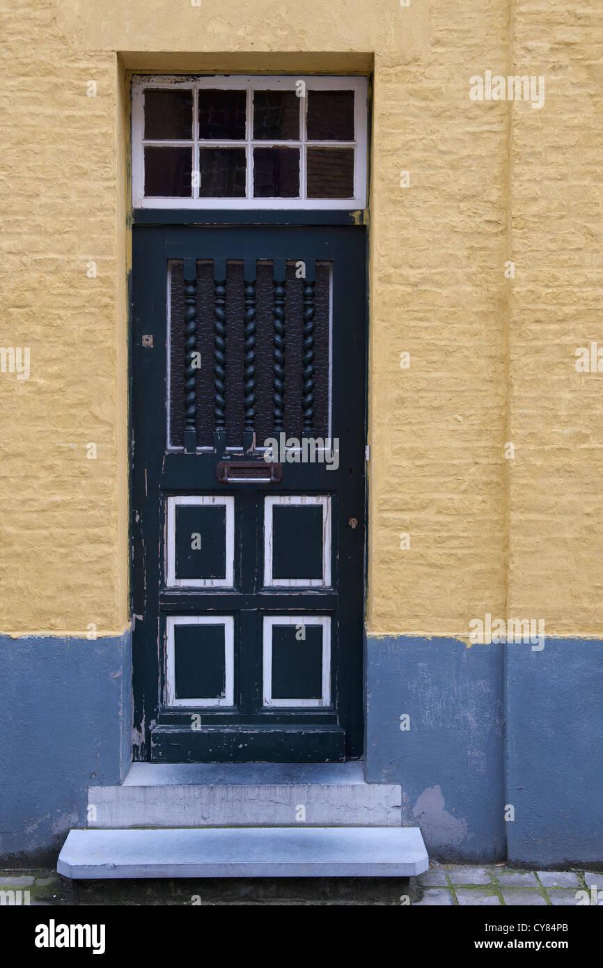 Old blue wooden front door in need of painting. Door is main ...