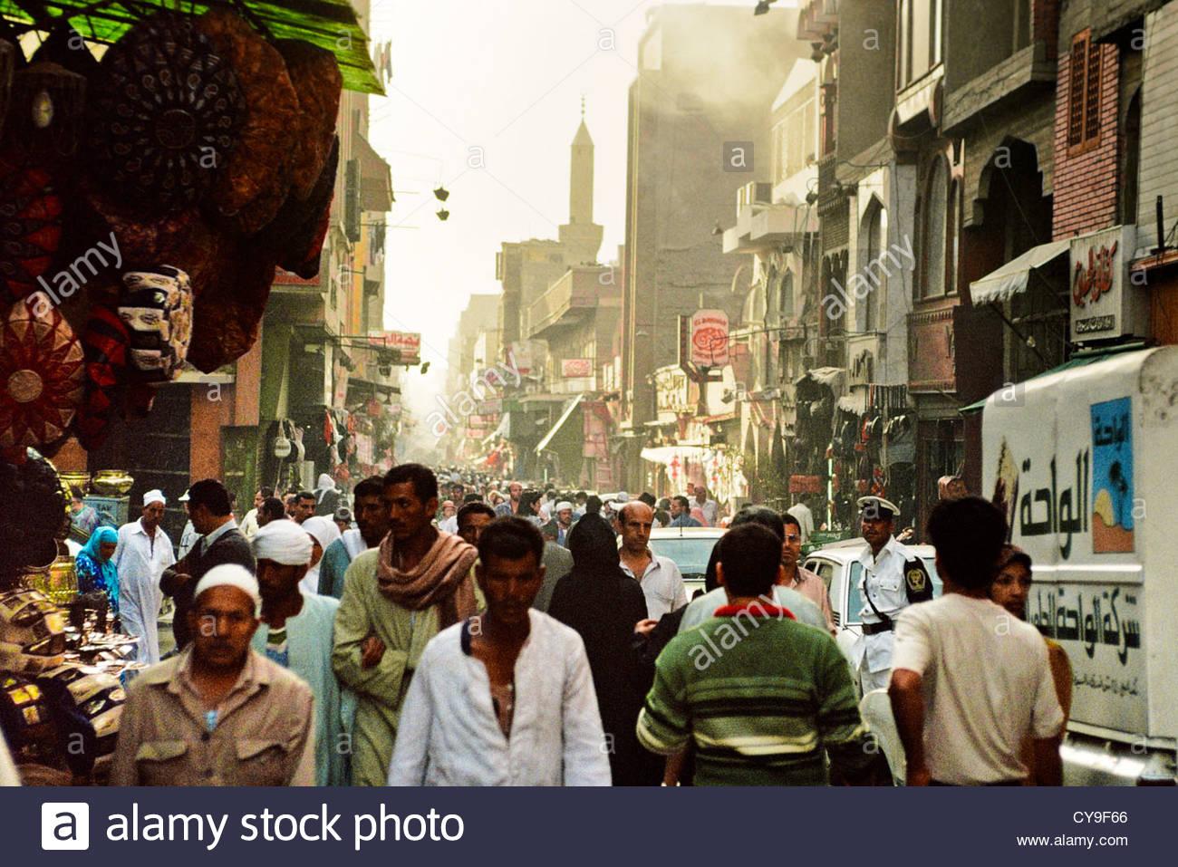 People walk through the street in the bazaar in old cairo Cairo shop