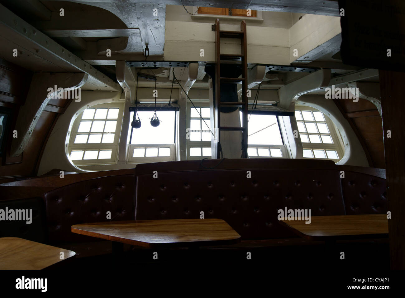 Interior looking out the stern window of the HMS Bounty, a tall ship ...