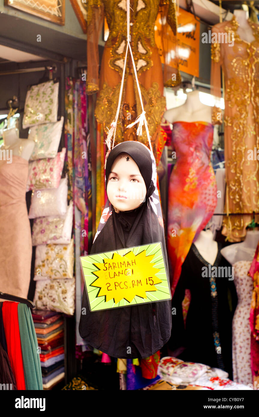 What are the rituals to wearing a head scarf or hijab?
