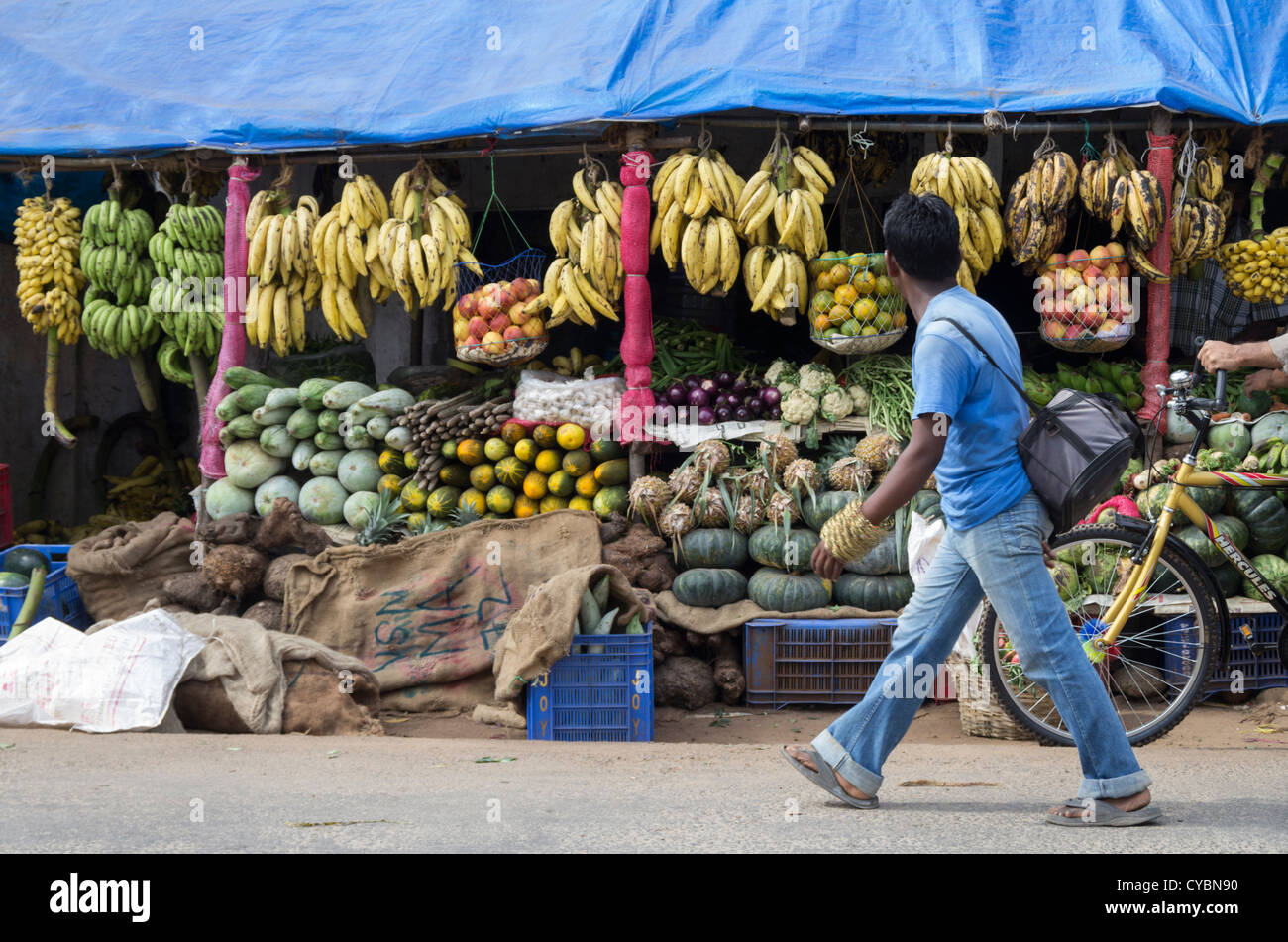 Walking past a fruit and vegetable store in a market in ...Kerala Vegetable Market