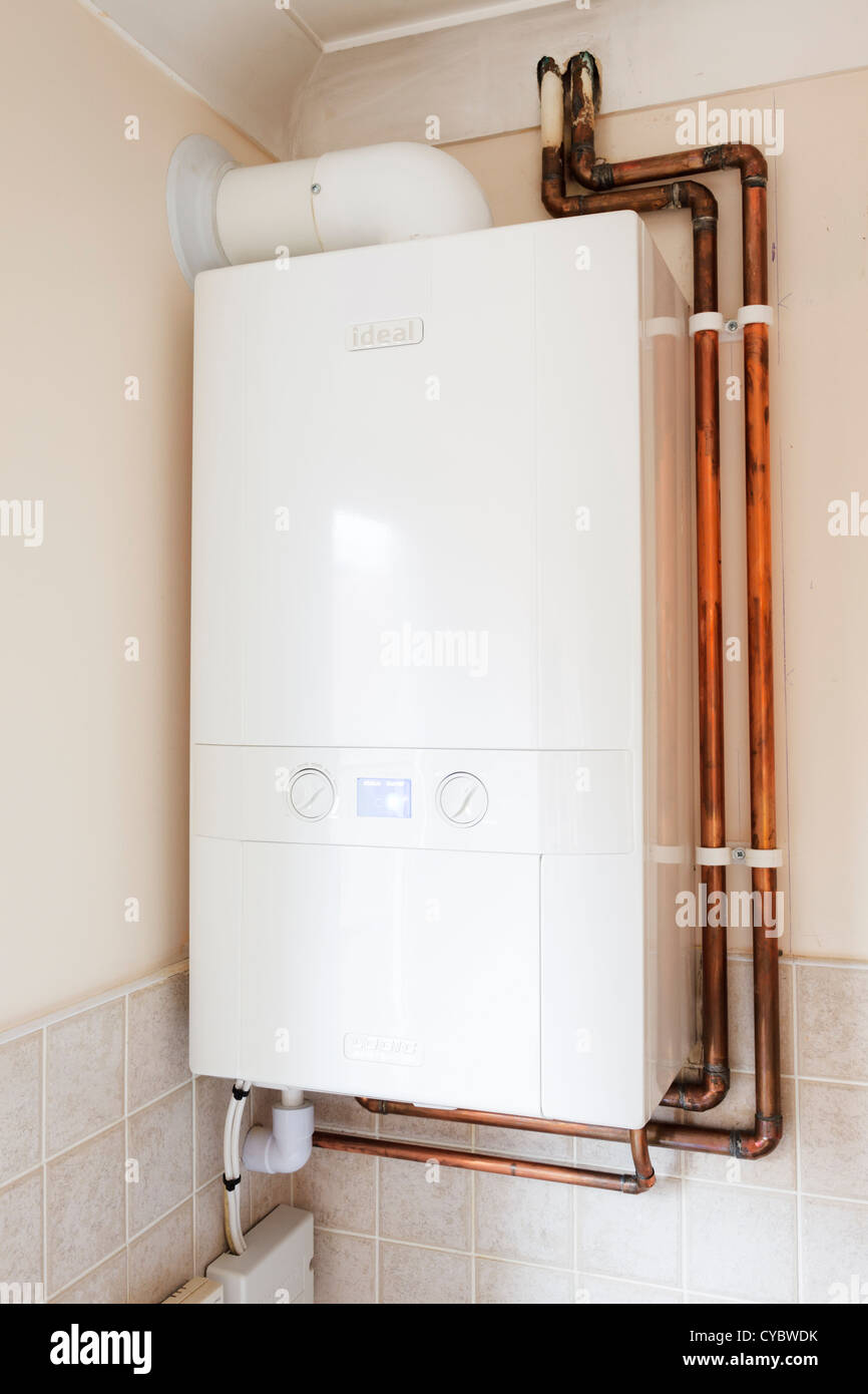pipework and house stock photos pipework and house stock images new condensing gas central heating boiler in a kitchen in a house uk stock