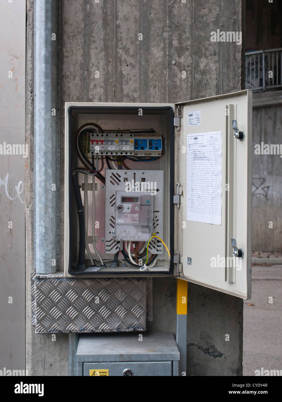 outdoors electrical junction connection or fuse box open for outdoors electrical junction connection or fuse box open for passers by to inspect