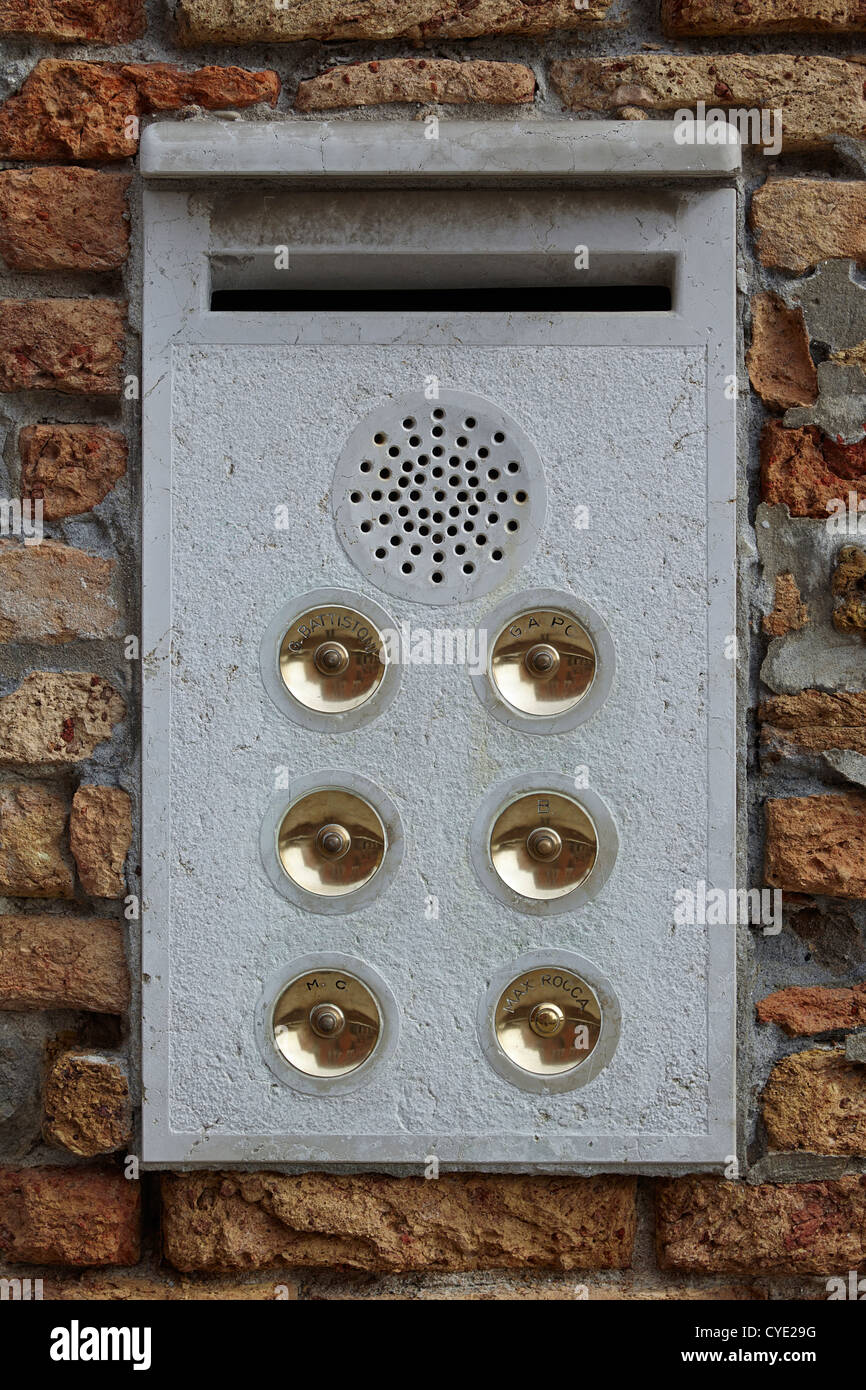 six door bells in a panel outside a venice apartment