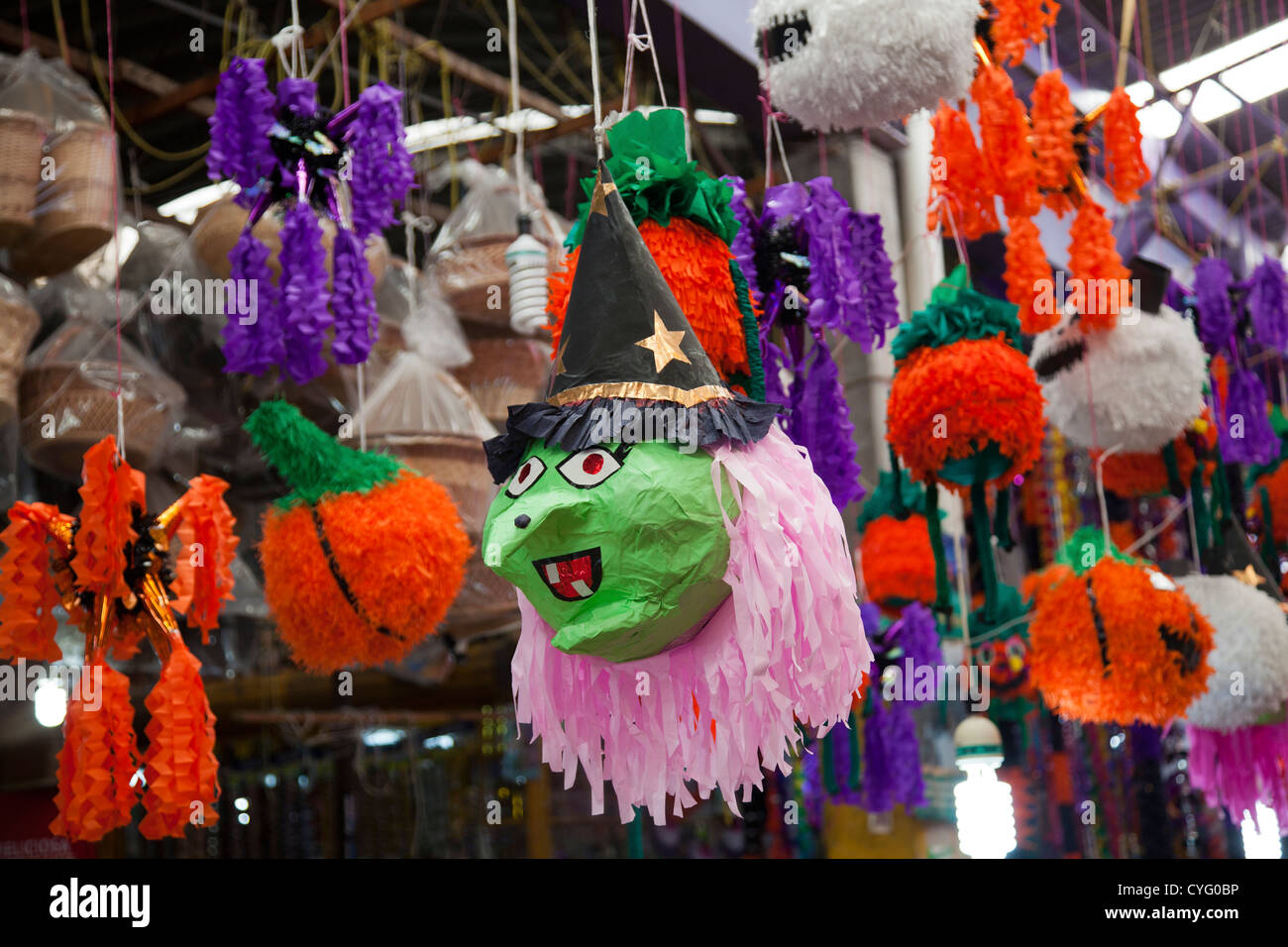 halloween paraphernalia and pinatas at jamaica market in mexico