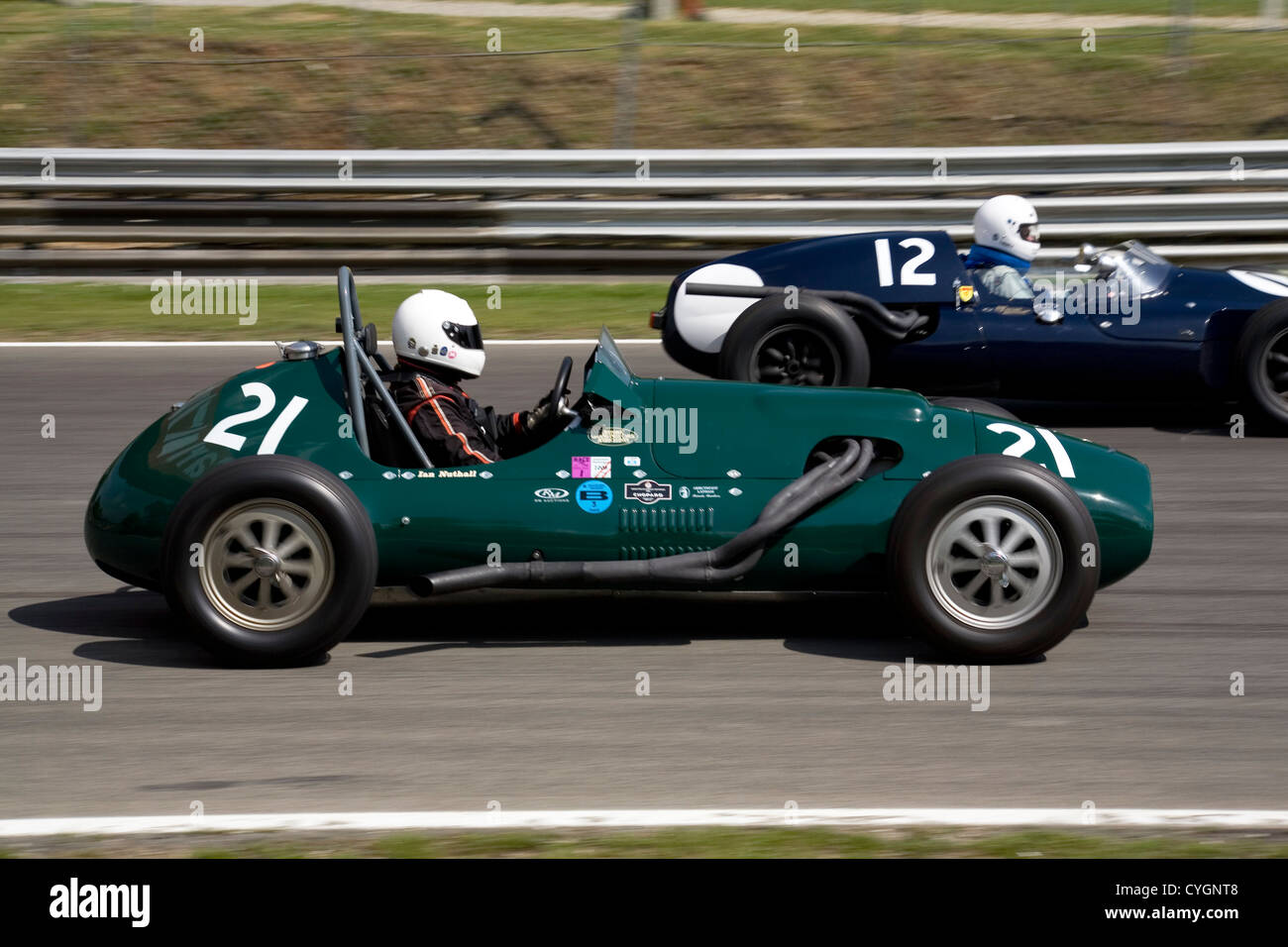 Two Classic Single Seater Racing Cars On A Racing Track Stock