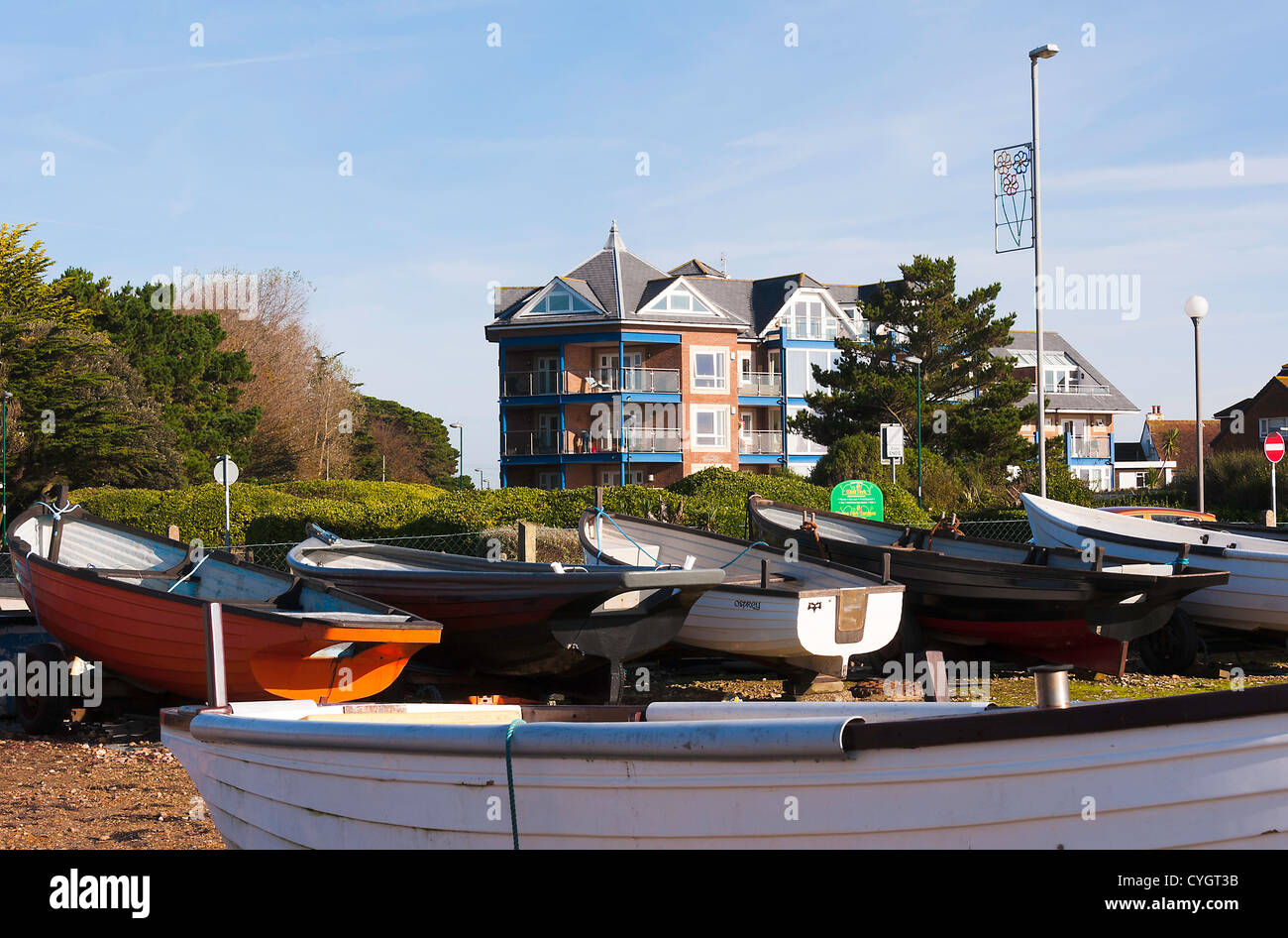 Small Inshore Fishing Boats In Park With Residential Home Apartment Block Aldwick Bognor Regis West Sussex