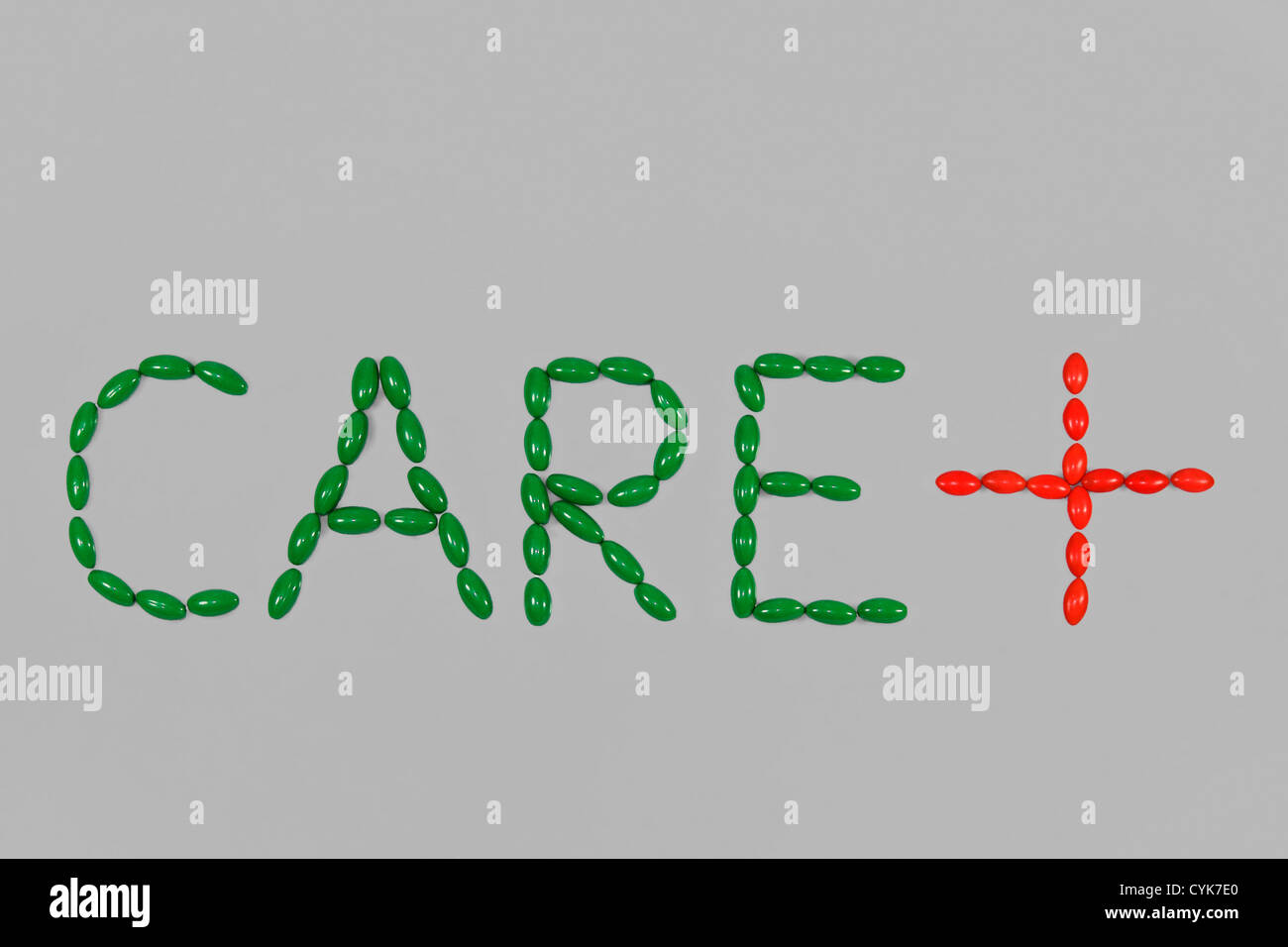 Care word with cross symbol arranged with pills stock photo care word with cross symbol arranged with pills buycottarizona Choice Image