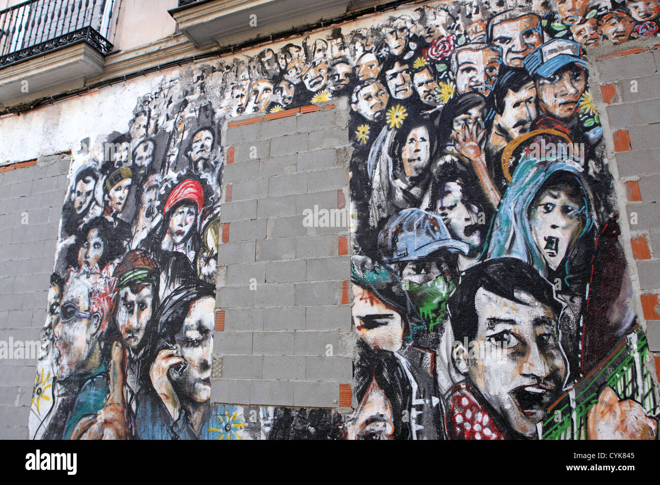 mural showing crowd of faces wall with bricked in