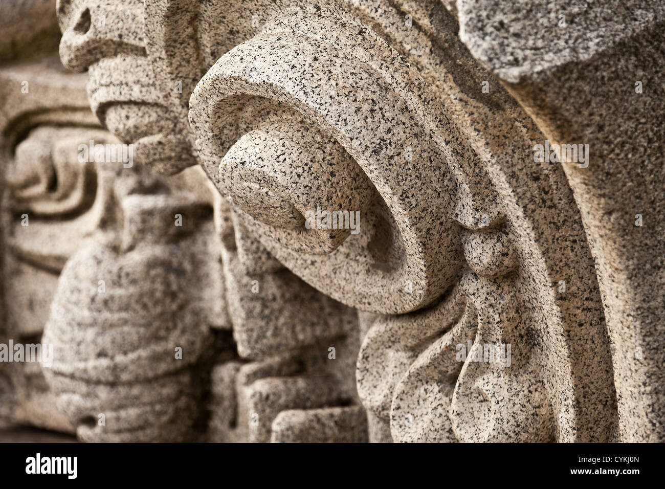Stone carving from granite rock facade of old historic