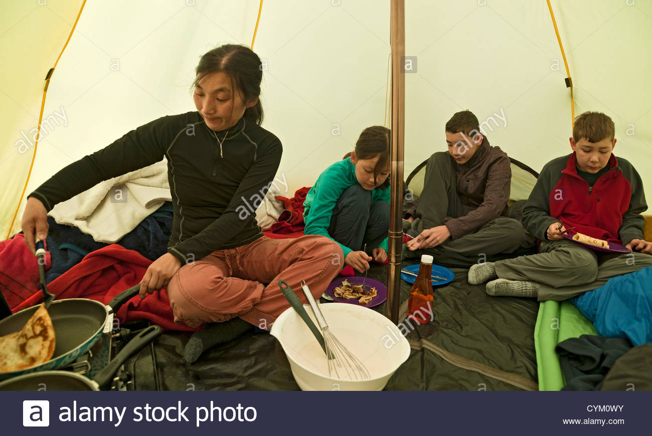 Family eating together in c& tent  sc 1 st  Alamy & Family eating together in camp tent Stock Photo Royalty Free ...