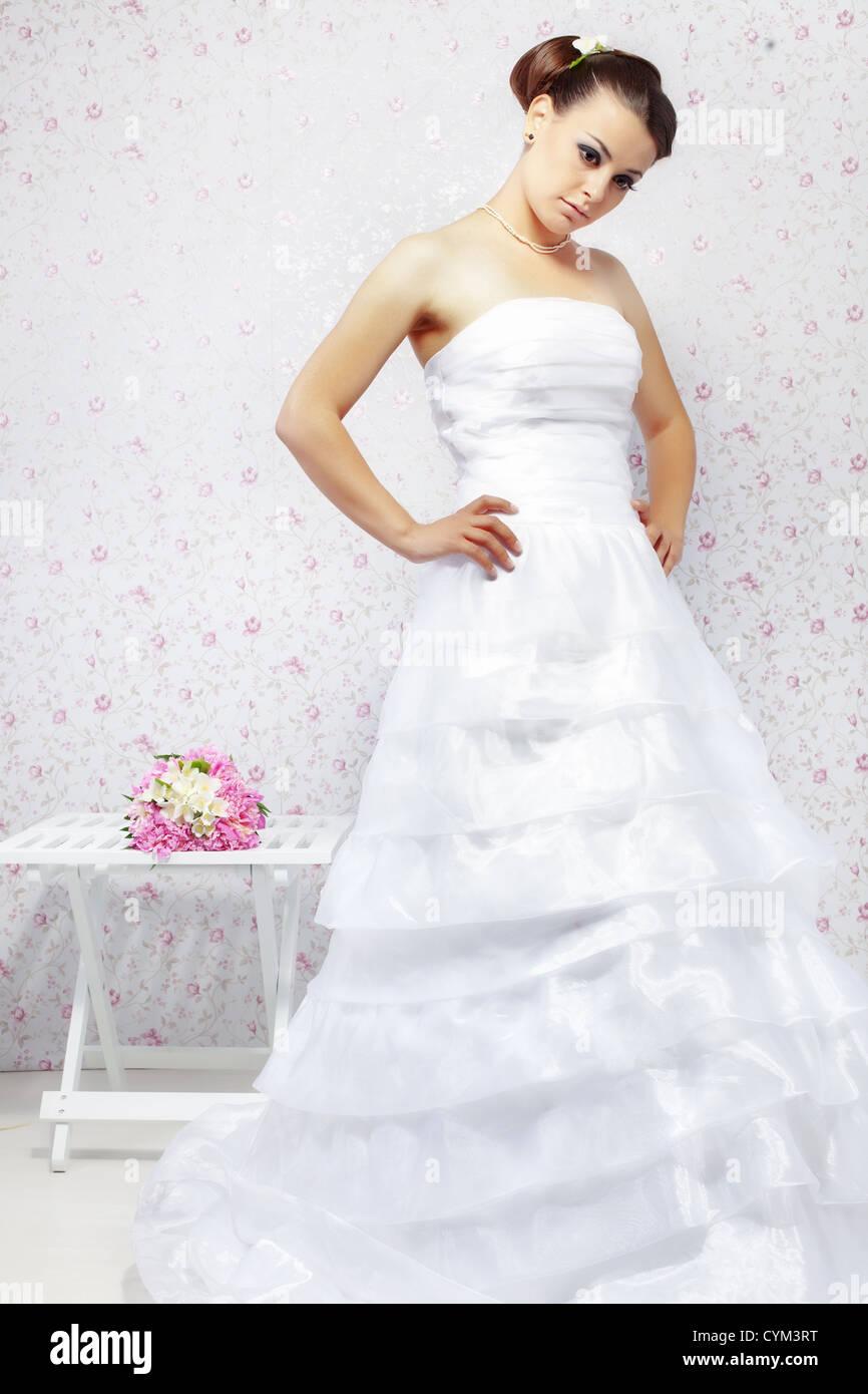 Beautiful young bride wearing fashion wedding dress Stock Photo ...