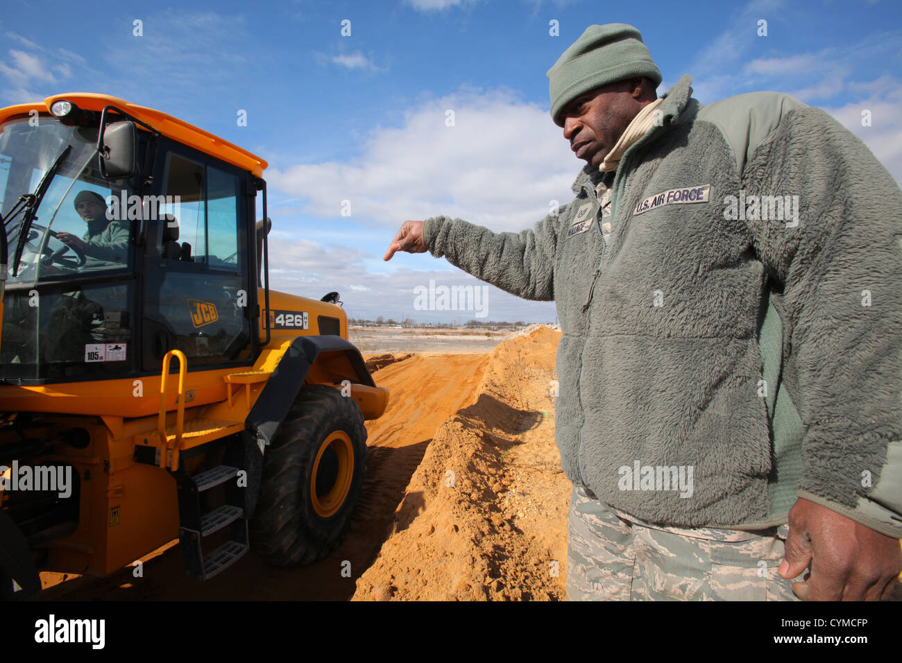 tech sgt delroy wallace standing directs front end loader