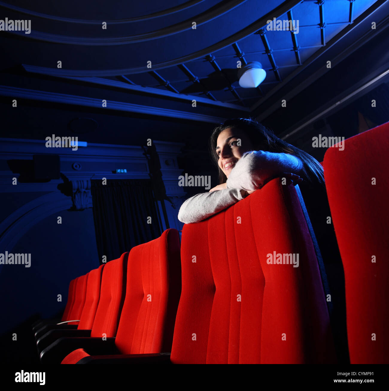 Stock photo dramatic red old fashioned elegant theater stage stock - Portrait Of A Girl In A Movie Theater Stock Image