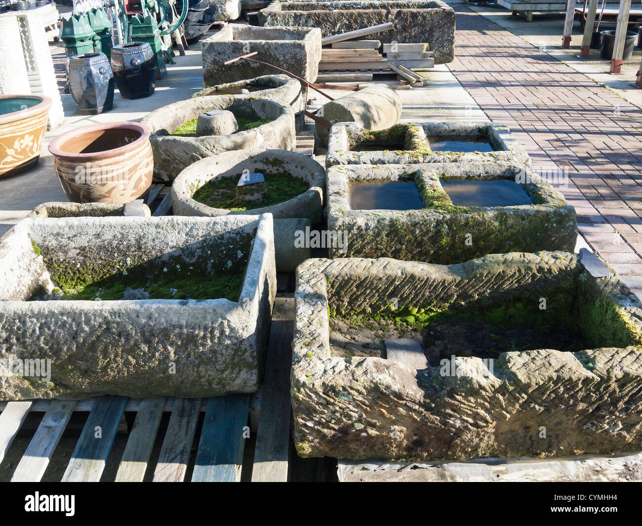 Garden centre display of old stone troughs salvaged from for Large garden stones for sale