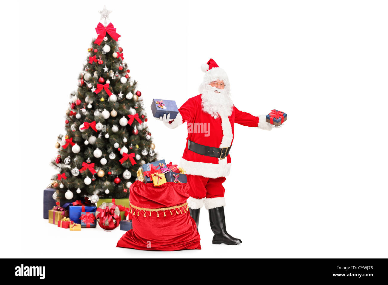 Santa claus giving gifts from a bag full of presents and decorated santa claus giving gifts from a bag full of presents and decorated christmas tree in the background negle Gallery
