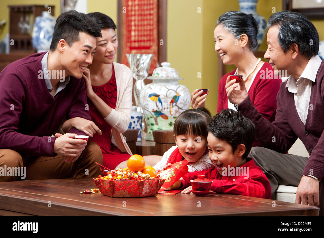 Happy family celebrating Chinese New Year with decorations ... |Family Celebrating Chinese New Year