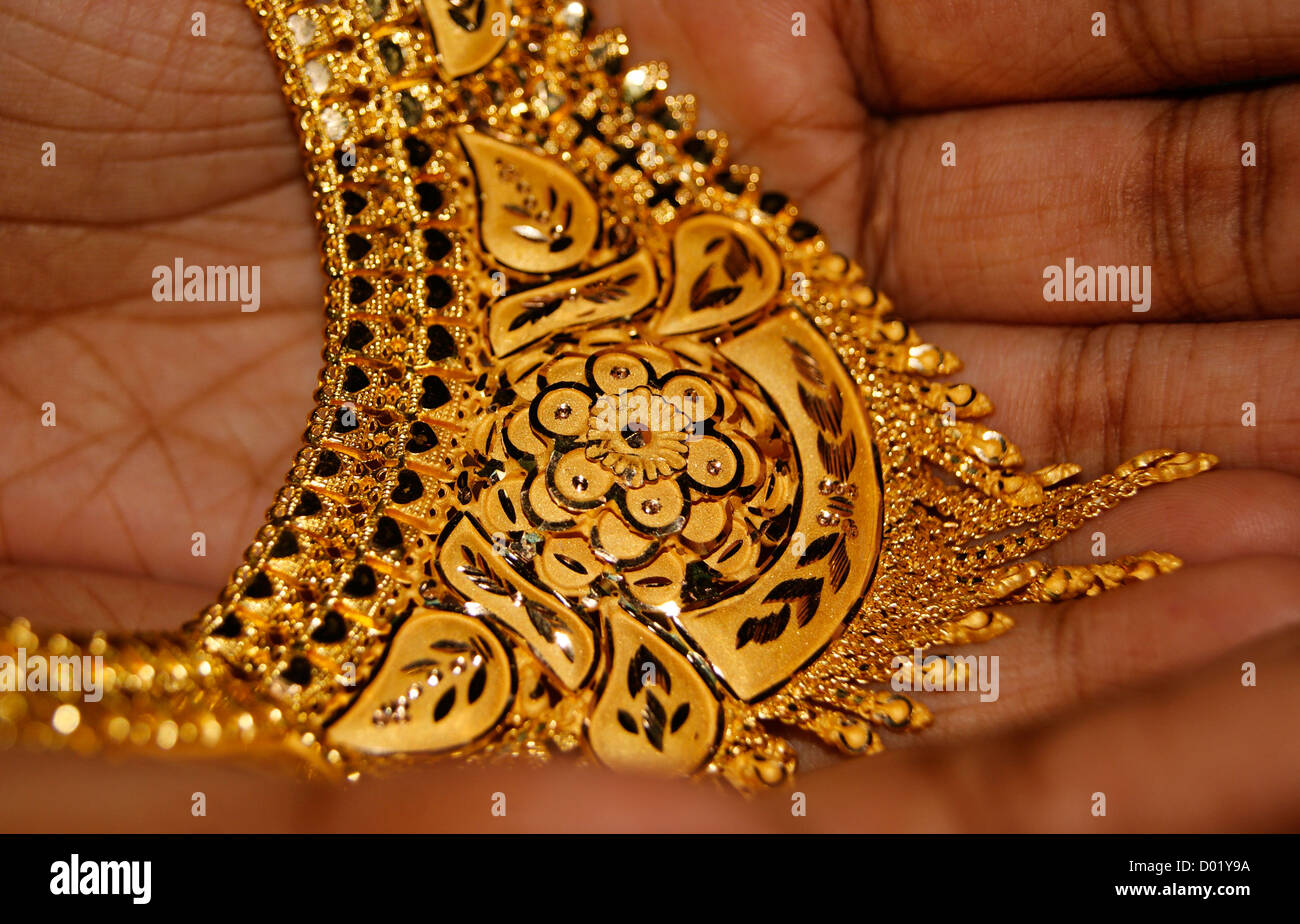 Designed Golden Necklace Jewellery on Hands.Bridal Gold Design ...