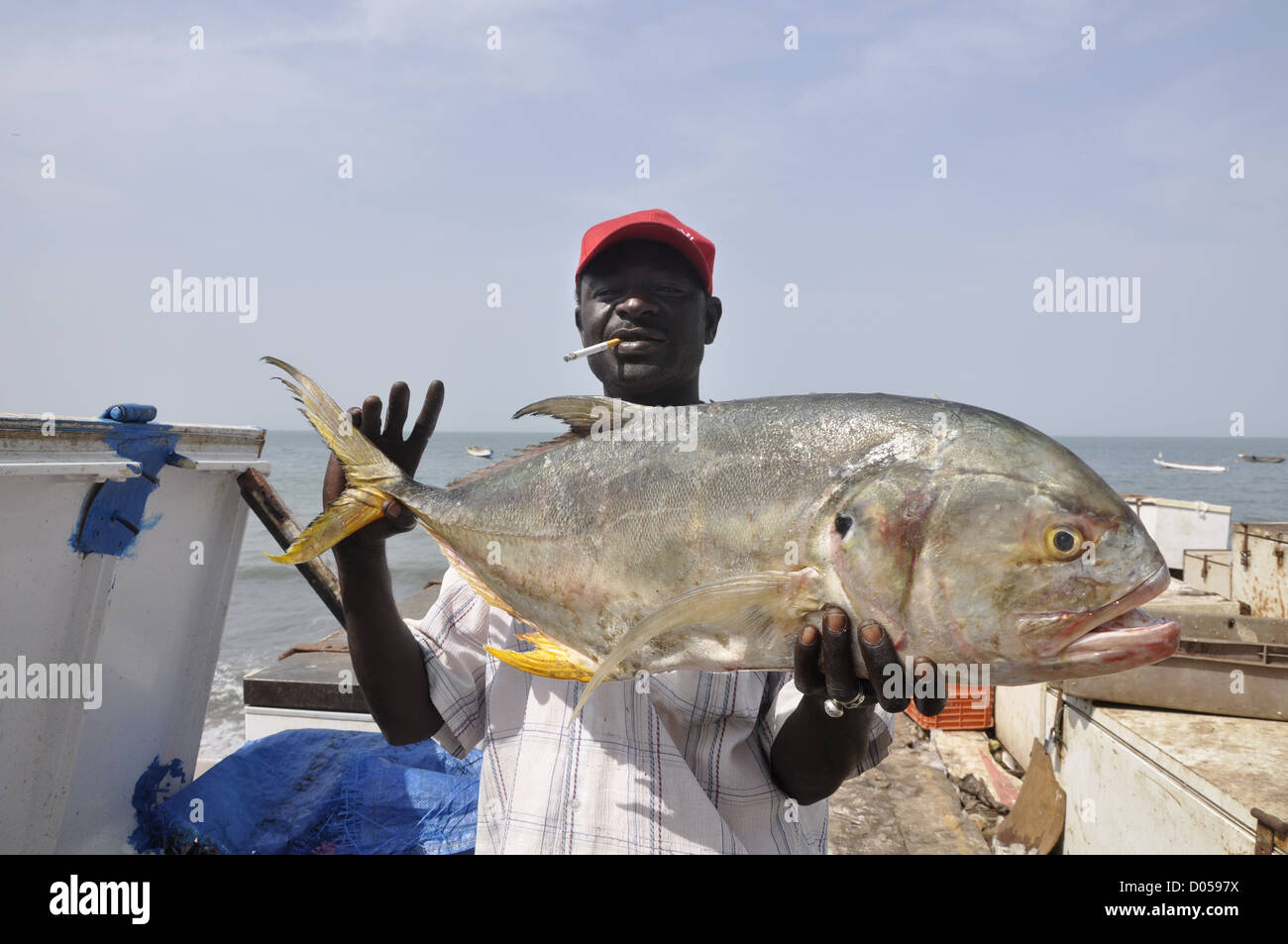 man-with-big-fish-in-bakau-harbour-the-g