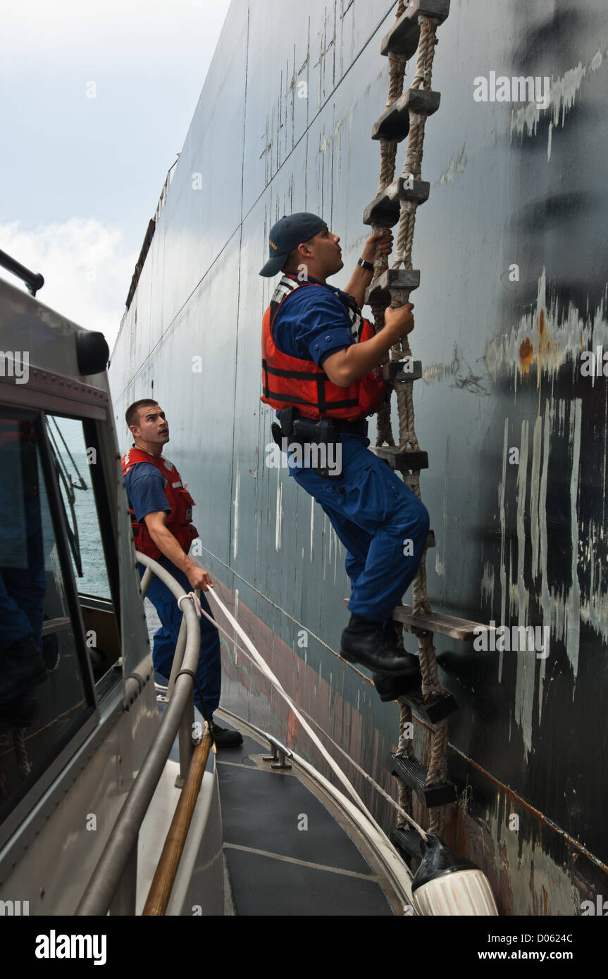 US Coast Guard agents climb rope ladder to board a tanker ship ... for Rope Ladder Ship  570bof