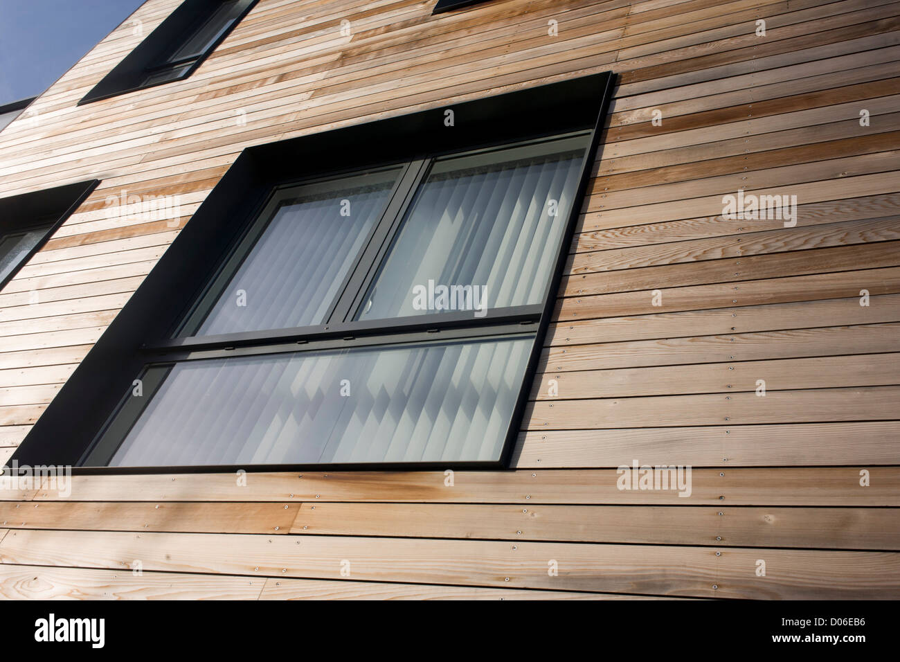 We look upwards to wooden panels on exterior walls of modern Stock ...