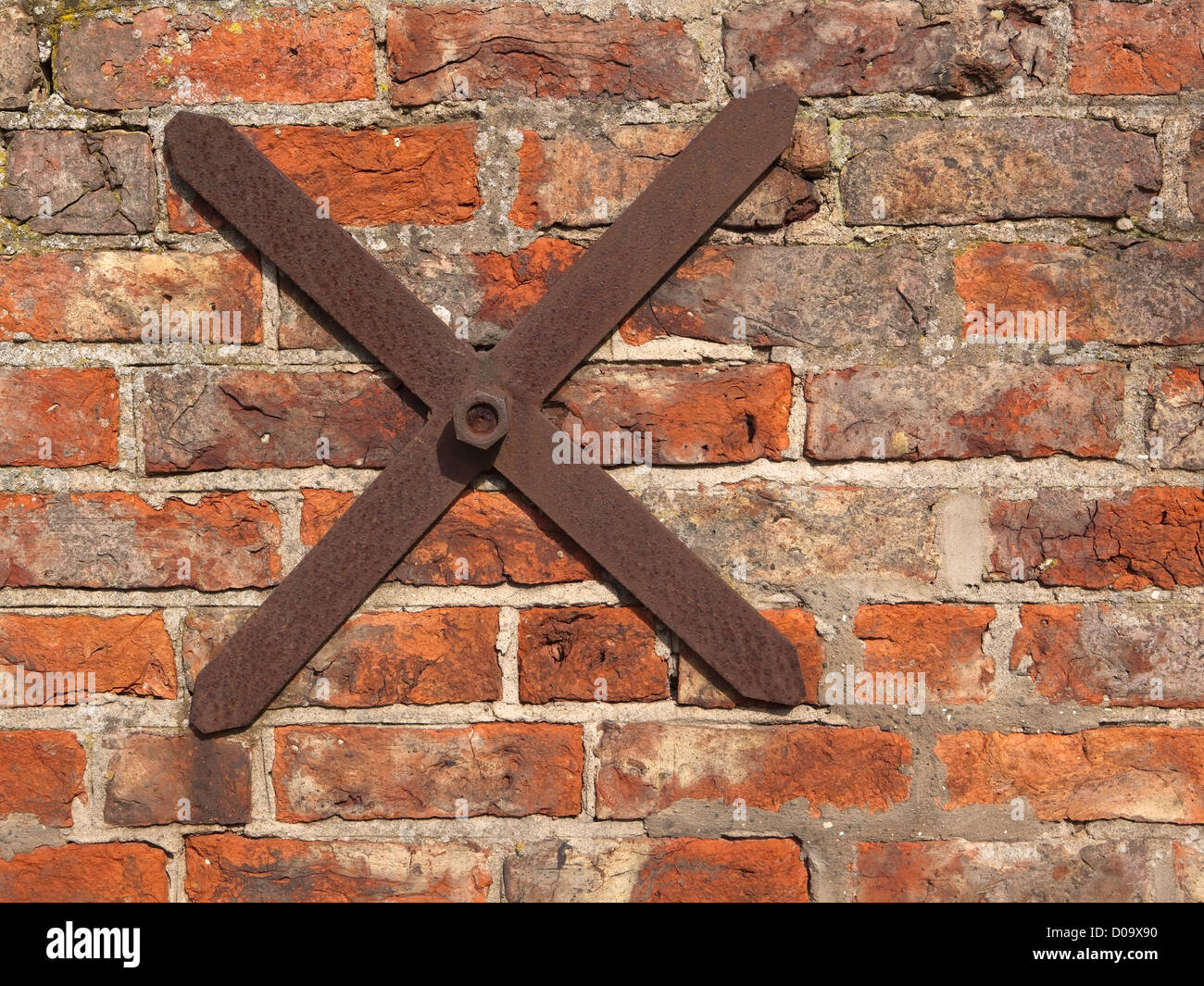 an old red brick wall with a rusty cross shaped iron tie bar stock photo royalty free image. Black Bedroom Furniture Sets. Home Design Ideas
