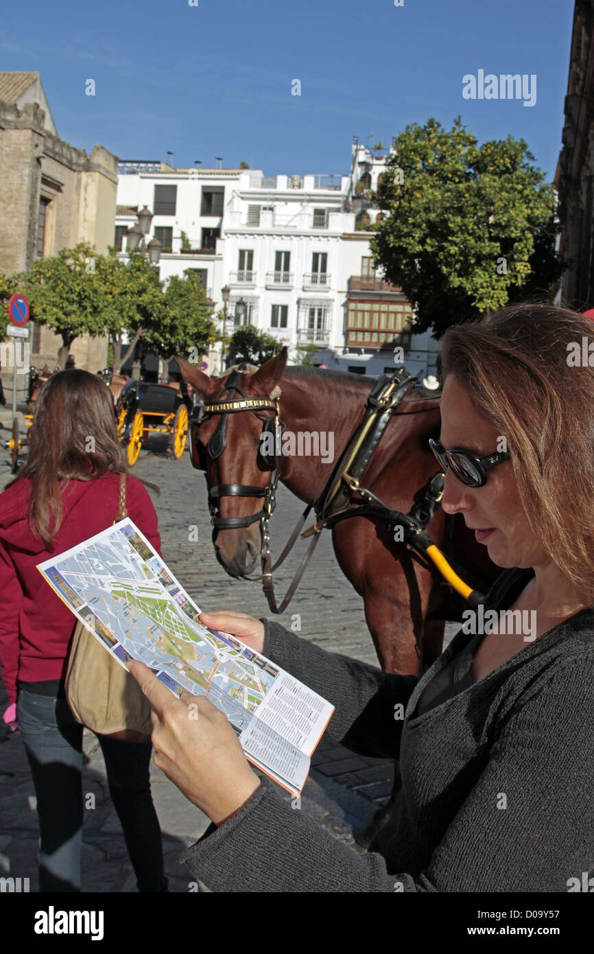 MAP TOURIST HORSE OLD TOWN SEVILLE ANDALUSIA SPAIN Stock Photo